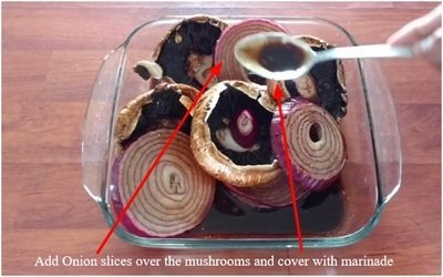 Add Onion slices over the mushrooms and cover with marinade
