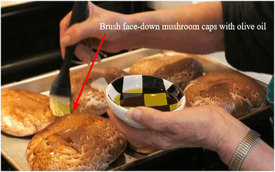 Brush face-down mushroom caps with olive oil