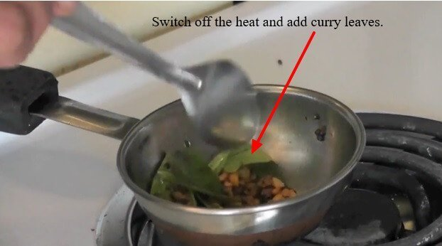 Switch-off-the-heat-and-add-curry-leaves.