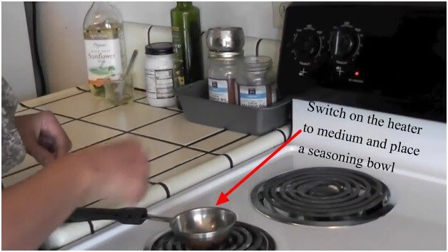Switch-on-the-heater-to-medium-and-place-a-seasoning-bowl